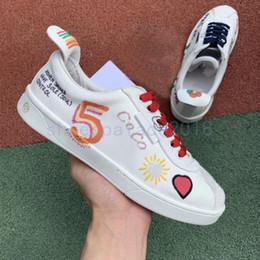 брезентовые туфли Скидка 2019 Новые повседневные дизайнерские кроссовки ShoesBest Canvas White Shoes Граффити CoCo Joint Пара Мужчины Женщины Обувь Повседневная спортивная обувь Chaussures