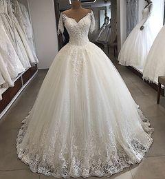 2dac0bc8b8a9 Abito da sposa di lusso Sparkly Ball Gown 2019 New White manica corta  Appliqued Vintage Abito da sposa su misura