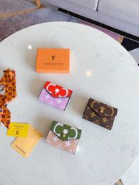 Argentina Kat nuevas carteras de cuero pulsera mujeres monederos bolsos de embrague cremallera tarjeta con regalo gratis moneda zippe 0729 Suministro