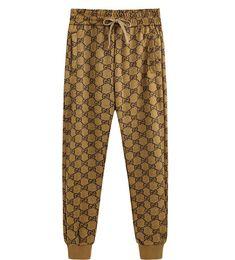 2019 pantalones de jogging amarillo hombres Mens Joggers Summer G Pantalones casuales de los nuevos hombres Blanco Lados rojos Pantalones elásticos de rayas Silk Wild Pantalones rectos Pantalones para hombre