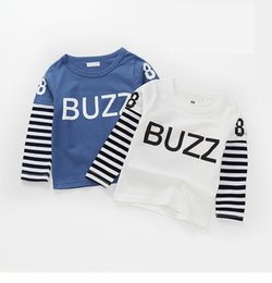 modelos de camiseta de los niños Rebajas hijos explosión modelos de otoño de algodón de manga larga a rayas de los nuevos niños chicos y chicas de la camiseta del bebé que basa la camisa falsificación dos