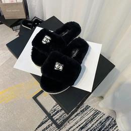 Sandalias de invierno de las niñas online-Zapatillas de invierno cálidas para niña de interior Logotipo de moda Zapatos caseros suaves Sandalias casuales de lujo para regalo de cumpleaños