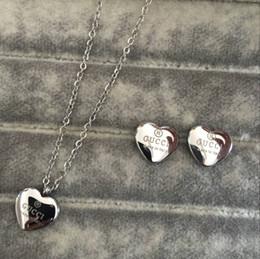 Argentina El nuevo collar y los pendientes del corazón del diseñador de la marca de fábrica 2019 doblan los conjuntos de la joyería de la letra oro de la plata del rosa 18k del oro de la boda de las mujeres Envío libre supplier zirconia necklace sets Suministro