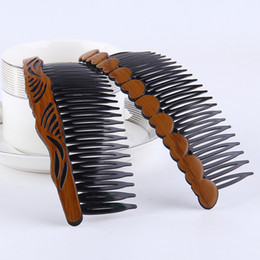 plastic hair comb clips Coupons - Plastic wood lines hollow five-pointed star bow comb Korean version of Mom's fashion vintage hair comb wholesale