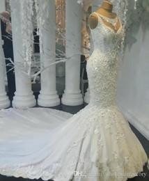Luxus Arabisch Dubai Lace Mermaid Brautkleider Applique 3D Floral Applique Perlen Kristalle Gericht Zug Brautkleid Brautkleider Vestidos von Fabrikanten