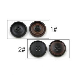 Canada 200 pièces / lot 22 mm classiques bouton de manteau de survêtement féminin de bouton de manteau des hommes de l'oeil en résine noir bouton rond version coréenne bouton de torsion Offre