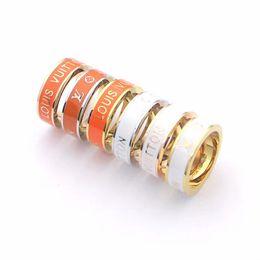 búho bolsas de regalo de navidad Rebajas anillos de las mujeres de lujo de la joyería del diseñador de Balck Flores naranjas par de anillos de plata de acero de titanio de oro rosa de 18 quilates de oro los anillos de compromiso para los hombres
