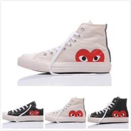 mode haut-pars baskets hommes Promotion 2019  All Stars nouveau chaussures de skate des années 1970 classique toile occasionnels jouer conjointement de grands yeux nom haut top dot coeur wmens hommes designer de mode sneakers 36-45