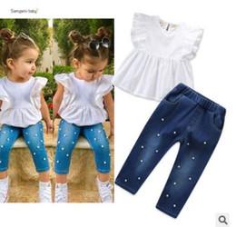 748d248fa44c1 Çocuklar Giysi Tasarımcısı Kızlar 2019 Yaz Çocuk Kız Ruffles Beyaz T-shirt  Bluz Inci Kot Kalem Pantolon Tops 2 ADET Çocuk Giyim Set girl blouses on  sale