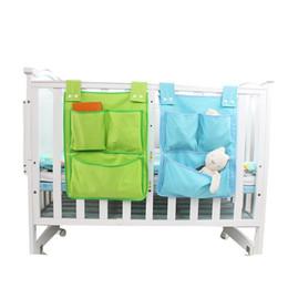 volle krippe bettwäsche setzt Rabatt Spielzeugwindeln Krippe Organizer Babybett Bett Hängen Tasche Lagerung Bettwäsche Set multifunktionale Bettwäsche Zubehör