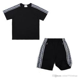 tracce di tuta Sconti tuta di moda per uomo estate casual balck t-shirt e pantaloncini pantaloni vestiti di marca di moda G G Pattern tute da uomo di design