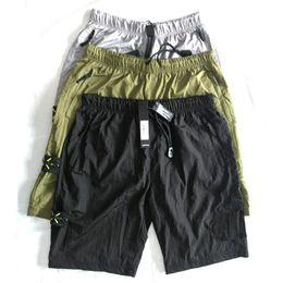 19ss Europeu marca quente retro calções casuais praia calças de suor para mens calças de metal importado de nylon confortáveis amantes de rua calças coxa de Fornecedores de calças de vestido azul do exército
