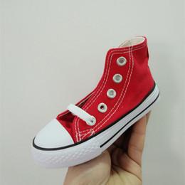 Argentina Zapatos de marca de alta calidad para niños Zapatos de lona Zapatillas de deporte de moda High Low Top Niños Chicas Zapatos de lona Sports Star Zapato de correr cheap kids fashion tops Suministro