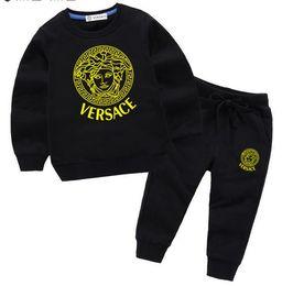 Jacken verkaufen online-HEIßER VERKAUF Neue Kinderkleidung Anzug Jungen / Mädchen Sportbekleidung Anzug Infant Jacket + Pants Kinder klassische Anzug 2-7 Jahre alt Größe 100cm-140