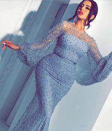 2019 selena gomez vestido marino 2019 Azul cielo Joya cuello Perlas con cuentas Vestidos de noche con mangas largas transparentes Ver a pesar Vestido de fiesta Vestido de fiesta de Dubai Árabe Formal Vestidos