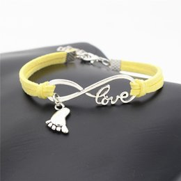 children quality bracelet Coupons - Hot Sale Women Men Infinity Love Child Foot Pendant Jewelry Fashion Yellow Leather Suede Velvet Rope Bracelets 2019 New Arrival High Quality
