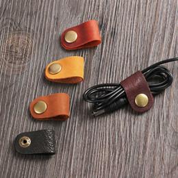 Enrollador de auriculares online-1pc Cable Winder Headset Auricular Cable Cable USB portátil Cable Winder de cuero Juego de escritorio Organizador de alambre Administrador de escritorio