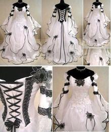 Abiti da sposa linea A Gothic Plus Size vintage con maniche lunghe Abito da sposa in pizzo nero con scollo a giro in pizzo per il giardino da