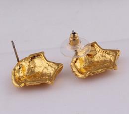Canada Haute qualité bijoux dame boucles d'oreilles en Europe et en Amérique Angel Head Ear Nails Offre