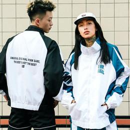 Europäische und amerikanische Fall Jacke Trench Mode Version Hip Hop Brief dünner Mantel Herren Top Paar Ladung loser Trend Trench