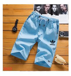 Calça on-line-Calças homens Carga Mens ADDIAS Casual Bezerro de comprimento Pants Man solta calças cortadas Multi-pocket vigas macacões macho Sports Curto