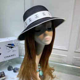 chapeau de paille noir réglable Promotion 2019 chapeaux pour femme Mode réglable broderie casquette de baseball plat blanc femmes Nouvelle paille célèbre pot noir et blanc tempérament de déesse