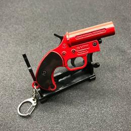 Juego Juguetes Clave Chian Playerunknown's Battlegrounds PUBG Llavero Flare Gun Rojo Alloy Pendant Men Llaveros Joyas Para Hombres desde fabricantes