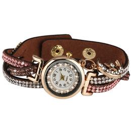 Elegante orologio al quarzo da donna Elegante quadrante bianco arabo con cinturino in pelle orologio da polso Elegante fascia tempestata di diamanti con ciondoli a forma di luna cheap diamond chic da diamante chic fornitori