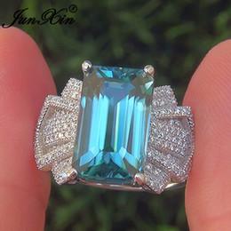 bf23a39f86ca JUNXIN Lujo Aqua Azul Piedra Anillos de Boda Para Las Mujeres 925 de Plata  Grande Lleno de Cristal Austriaco Anillo de Compromiso Joyería Femenina CZ  ...