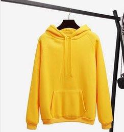 Casacos de inverno para mulheres cor amarela on-line-Outono E Inverno Amarelo Manga Longa Com Capuz Casuais Moletom Com Capuz 2018 Novo Moda Pure Color Solto Top Moletom Com Capuz Casaco