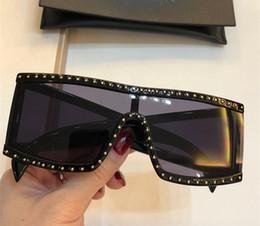 marche punk occhiali Sconti 004 Fashion New Brand Designer Occhiali da sole Retro Frameless Occhiali da sole Vintage stile punk Occhiali Protezione UV400 di alta qualità Con scatola
