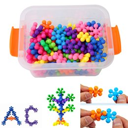Juguetes gratis modelos 3d online-Envío gratis 100 unids 3D Puzzle Jigsaw plástico Plum Blossom modelo de construcción Puzzle juguetes educativos para niños