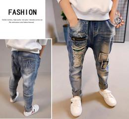 Enfants portant des jeans en Ligne-Les enfants portent des pantalons pour garçons printemps 2019 jeans pour garçons trou trou pour garçon