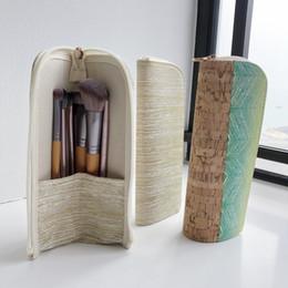 Cepillo de maquillaje permanente protección del medio ambiente grano de madera color metal bolsa de almacenamiento portátil bolsa de cepillo desde fabricantes
