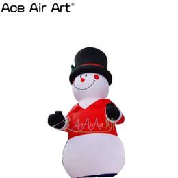 bonhomme de neige gonflable Promotion Sourire bonhomme de neige gonflable de Noël avec chapeau noir, bonhomme de neige gonflable de vêtements rouges pour Noël