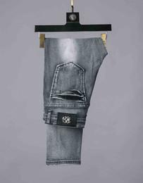 2019 manchas de pantalones Spot DG jeans para hombre de diseñador de alta calidad Hole jeans Marca de ocio Pantalones vaqueros ajustados Pantalones de locomotora para montar Pantalones de algodón de moda rebajas manchas de pantalones