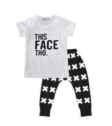 INS Ropa de bebé Ropa de verano para niños Juegos de ropa Carta de algodón informal Camiseta blanca Tees cruzados negros Niños Ropa para niños al por mayor 050 desde fabricantes