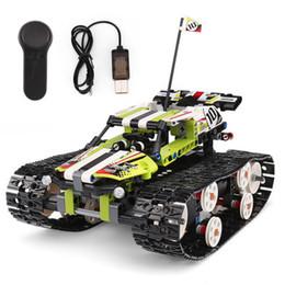 2019 grandes camiones de control remoto Bloques de construcción eléctricos de control remoto tanque sobre orugas carreras de alta velocidad que ensamblan e insertan bloques de juguetes de control remoto