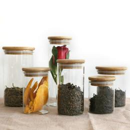Deutschland Transparente Glas-Vorratsbehälter für Lebensmittel Korken Deckgläser Flaschen für Sand Flüssige Lebensmittel Umweltfreundliche Glasflaschen mit Bambusdeckel cheap bamboo food cover Versorgung
