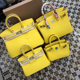 Wholesale 35CM CM CM CM Marca mujer Totes Amarillo Bolsos de cuero genuino Con un mejor bloqueo Fashion lady Handbag Factory imagen Real
