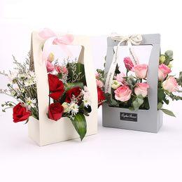 10 pz / lotto cesto di fiori di carta da imballaggio 4 colori portatile tenuto in mano regalo scatole impermeabili scatole di imballaggio di fiori per la festa nuziale 1 lotto DHL da