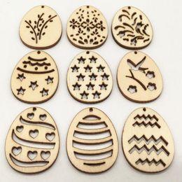 100 unids DIY Botones De Madera 38mm * 30mm Huevos de Pascua Felices DIY Huevo de Madera Artesanía Decoración de Pascua Chip de Madera Colgante de Pascua Colgando adornos desde fabricantes