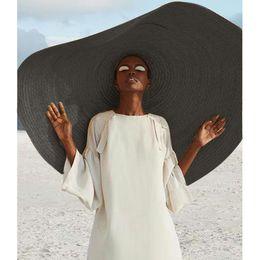 Sombreros plegables sol online-Tapa mujer de la manera grande del sombrero de Sun Beach anti Protección Solar plegable de paja de gran tamaño sombrero de paja plegable sombrilla de playa