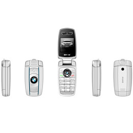 Sim, telefones gratuitos baratos on-line-Nova Celulares mini Telefone Bolso BMW X6 Chave Do Carro Anti-Lost FM GSM Leitor de Música pequeno e barato Telefones Bluetooth Dailer Frete Grátis de Fábrica