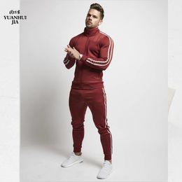 gli uomini mette in mostra gli insiemi di abbigliamento sportivo Sconti Mens Tuta divendita di Sportswear Set Autunno Inverno a maniche lunghe zip con cappuccio Pantaloni Moda jogging Set Asiatica Misura