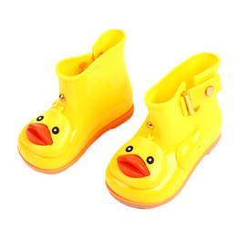 Zapatos de barril online-NUEVAS botas de lluvia de pato amarillo Zapatos de agua de barril bajo Zapatos impermeables para niños Botas de nieve Botas de lluvia antideslizantes 4 colores