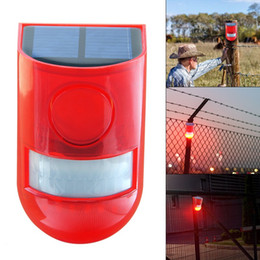 Alarmas solares online-El más reciente de alarma Luz solar de 110 dB lámpara solar de 6 LED a prueba de agua solares Luces de advertencia del sonido de la alarma del sensor de movimiento con las lámparas