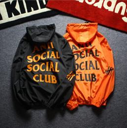 Chaqueta formal casual de las mujeres online-Venta caliente de los hombres chaqueta de abrigo mujeres hombres carta impresa con capucha suelta ropa de protección solar envío gratis