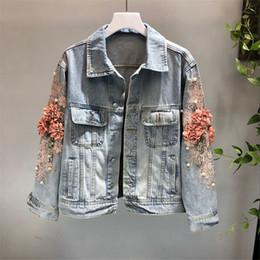 Argentina 2019 otoño mujer bordado tridimensional flor lavado corto de manga larga chaqueta de mezclilla azul claro damas Jeans chaqueta supplier ladies embroidery jackets Suministro