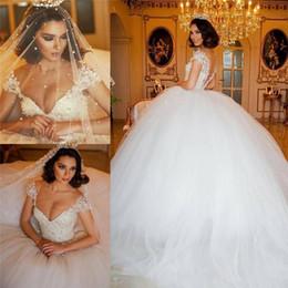 Túnica dubai mariage online-Vestidos de novia góticos árabes de lujo Vestidos de novia Ilusión Blusa Perlas Con cuentas Medio Oriente Dubai Vestidos de novia Robe De Mariage